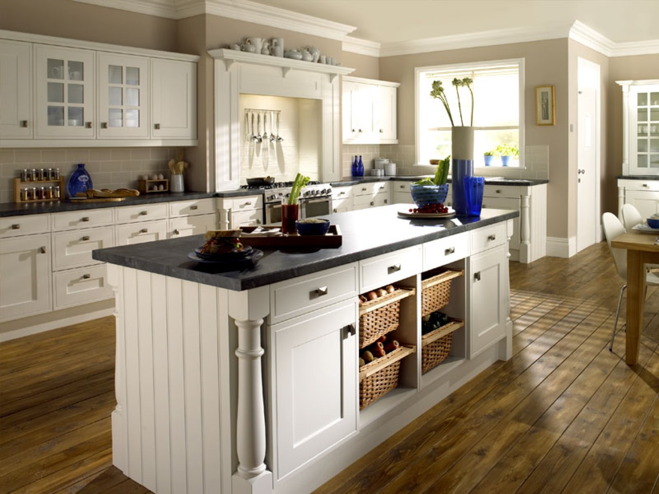 hardwood-floor -design-with-large-island-and-pretty-white-cabinets-in-beautiful-farmhouse- kitchen-plus-roller-window-blind